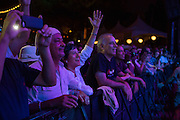 An enthusiastic crowd in front of the stage, cheering Eddie Palmieri.