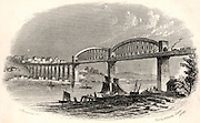 The Royal Albert Bridge (Viaduct) at Saltash.  The Bridge carrying the railway over the estuary of the Tamar at Saltash and linking Devon and Cornwall, England.   Inaugurated by Prince Albert in May 1859, this was Isambard Kingdom Brunel's last masterpiece.  His use of prefabricated wrought iron tubes in this bow-string girder bridge was on a much larger scale than his innovative bridge at Chepstow. Engraving.