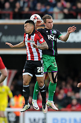 Joe Bryan of Bristol City challenges for the header with Nico Yennaris of Brentford - Mandatory by-line: Dougie Allward/JMP - 16/04/2016 - FOOTBALL - Griffin Park - Brentford, England - Brentford v Bristol City - Sky Bet Championship