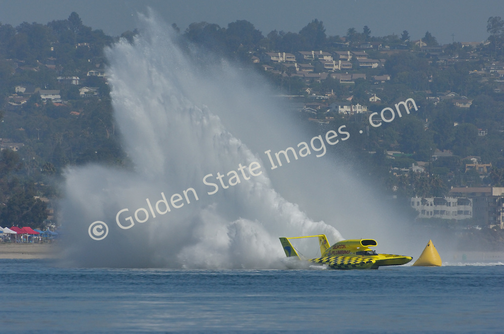 Hydroplane Throwing a Monster Roostertail in Turn Three.<br /> <br /> Each year in September the unlimited hydroplanes return to San Diegos  Mission bay to put on a show.
