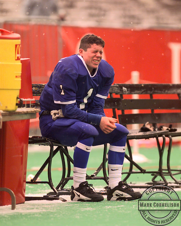 Harrodsburg quarterback  Daniel Hopewell, couldnt hold back his tears as he sat on the bench during the final minute of Harrodsburgs 26-0 Loss to Beechwood in the State Championship in Louisville on friday December 5,1997.