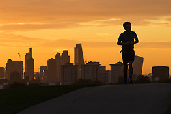 Primrose Hill, London, September 27th 2016. A runner's silhouette on Primrose Hill breaks the city skyline as a new day dawns over London. ©Paul Davey<br /> FOR LICENCING CONTACT: Paul Davey +44 (0) 7966 016 296 paul@pauldaveycreative.co.uk