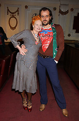 Top British fashion designer VIVIENNE WESTWOOD and her husband MR ANDREAS KRONTHALER at the launch of 'Grand Classics:Films with Style' series in London hosted by Vivienne Westwood at The Electric Cinema, Portobello Road, London W11 on 20th March 2006.<br />