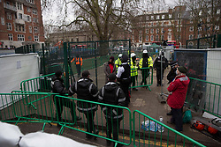 © Licensed to London News Pictures. 03/02/2021. London,UK. Bailiffs work to evict a group of eco-activists who are living in increasingly unstable tunnels beneath Euston Square Gardens in central London. The eviction of the HS2 Rebellion group from the square began one week ago and continues today.  Photo credit: Marcin Nowak/LNP