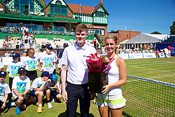 LIVERPOOL, ENGLAND - Sunday, June 24, 2018: Nick Bannon-Thomas, BMW, present flowers to Ellie Tsimbilakis (GBR) during day four of the Williams BMW Liverpool International Tennis Tournament 2018 at Aigburth Cricket Club. (Pic by Paul Greenwood/Propaganda)