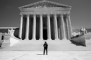 A solitary park policeman guards the vacant Supreme Court during the pandemic lockdown in Washington DC.