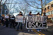 Protesters are seen gathering in front of the State College police station as they prepare to march.