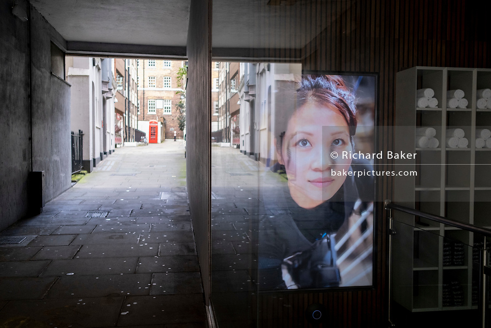 The face of a customer who is working out at a fitness business is seen through the screen of a closed gym during the second wave of the Coronavirus pandemic, on 26th October 2020, in London, England.