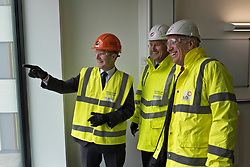 Pictured: Michael Matheson with Hubs' chief Executive Paul McGirk (open jacket) and Morrison Construction's project Director Phil Galbraith<br /> <br /> Infrastructure Secretary Michael Matheson visited East Lothian Community Hospital's construction site today to give an update on the Scottish Government's infrastructure programme, on the same day as an annual progress report is published<br /> <br /> Ger Harley   EEm 17 April 2019
