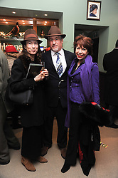 Left to right, SIMON KELNER, his wife SALLY ANN LASSON and KATHY LETTE at the Hennessy Gold Cup 2010 at Newbury Racecourse, Berkshire on 27th November 2010.