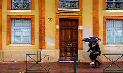 Peole with umbrellas walking in the rain in the Quai Saint-Pierre, Toulouse, France<br /> <br /> (c) Andrew Wilson | Edinburgh Elite media