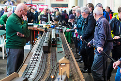 19/01/2018. London, UK. Enthusiasts watch as model Gauge '1' steam locomotives pass by at the London Model Engineering Exhibition at Alexandra Palace. Over 50 clubs and societies are exhibiting nearly 2,000 models constructed by their members. Photo credit: Rob Pinney