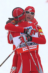 Bill Demong of USA holding winner Todd Lodwick of USA at Nordic Combined Individual Gundersen NH, 10 km, at FIS Nordic World Ski Championships Liberec 2008, on February 22, 2009, in Vestec, Liberec, Czech Republic. (Photo by Vid Ponikvar / Sportida)