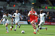 Southampton's Sam Gallagher © breaks past Swansea's Dwight Tiendalli. Barclays Premier league match, Swansea city v Southampton at the Liberty stadium in Swansea, South Wales on Saturday 3rd May 2014.<br /> pic by Andrew Orchard, Andrew Orchard sports photography.