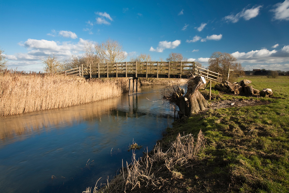 Wooden footbridge over the upper reaches of the River Thames near Cricklade, Wiltshire, Uk