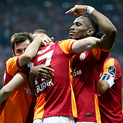 Galatasaray's Burak Yilmaz celebrate his goal with team mate during their Turkish superleague soccer derby match Galatasaray between Trabzonspor at the AliSamiYen spor kompleksi TT Arena in Istanbul Turkey on Saturday, 18 May 2013. Photo by Aykut AKICI/TURKPIX