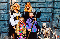 Toni with her daughter Josephine and her grandchildren Kelly and Christopher at the London Dungeon in the 1990s. Eighty-year-old great grandmother Toni Goldenberg save up her pennies to pay for a facelift in February 2019, giving her extra confidence and a look to match her youthful approach to life. Wallington, Surrey, March 28 2019.