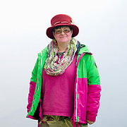 Portrait of a member of The Rhubarb Tarts Molly Dancing side at the Wakefield Rhubarb festival in Yorkshire, UK on 24th February 2018. Molly dancing is a form of English Morris dancing and is primarily associated with the fens of East Anglia. The Rhubarb Tarts hail from the famous Rhubarb Triangle in West Yorkshire and wear the colours of rhubarb - green, pink, red and yellow