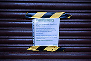 Sign on the shutters of a closed gym as the national coronavirus lockdown three continues on 28th January 2021 in London, United Kingdom. Following the surge in cases over the Winter including a new UK variant of Covid-19, this nationwide lockdown advises all citizens to follow the message to stay at home, protect the NHS and save lives.