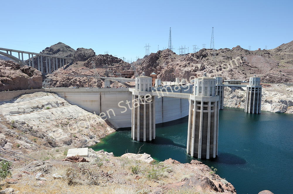 Intake towers at Hoover Dam.<br /> <br /> Hoover Dam is designed to never have the water level of Lake Mead overtop the dam. There are spillways on each side which route excess storage around the dam.