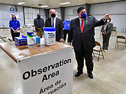 Illinois Governor J.B. Pritzker gestures as he tours the mass vaccination site at the Belle-Clair Fairgrounds in Belleville, IL on February 18, 2021. At left is St. Clair County Board Chairman Mark Kern. <br />Photo by Tim Vizer