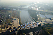 Nederland, Noord-Holland, Muiden, 11-12-2013; Amsterdam-Rijnkanaal in tegenlicht met in de voorgrond Uyllanderbrug naar IJburg en de Brug Muiden in autosnelweg A1.<br /> Amsterdam-Rine chanel with new bridge and motorway A1.<br /> luchtfoto (toeslag op standaard tarieven);<br /> aerial photo (additional fee required);<br /> copyright foto/photo Siebe Swart.
