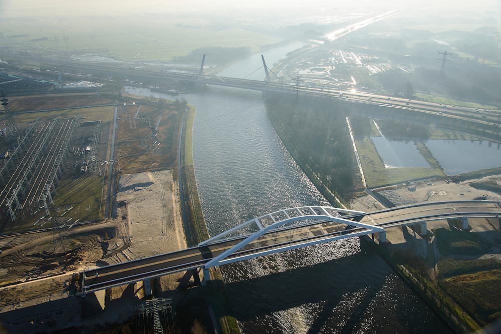Nederland, Noord-Holland, Muiden, 11-12-2013; Amsterdam-Rijnkanaal in tegenlicht met in de voorgrond Uyllanderbrug naar IJburg en de Brug Muiden in autosnelweg A1.<br /> Amsterdam-Rine chanel with new bridge and motorway A1.<br /> luchtfoto (toeslag op standaard tarieven);<br /> aerial photo (additional fee required);<br /> copyright foto/photo Siebe Swart.