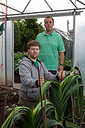 Brothers Kevin, 32, and Gareth, 30, Fortey.  After their father, one of the founders of competitive giant vegetable growing, died the brothers  decided to continue the tradition and may even pass it on to their children. Kevin's 4 year old son is growing giant sunflowers. Giant vegetable growing is not a hobby for the faint hearted. The growers have to tend to the vegetables almost every day (including Christmas) spending up to 80 hours a week, tending, nurturing, growing and spending thousands on fertilisers, electricity and green houses. The reward is to be crowned world record holder of largest, longest or heaviest in class, cabbages weighing in at 100lb, carrots stretching 19 ft and pumpkins tipping the scales at 800lb.
