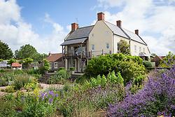 The gravel garden and house at Holt Farm organic garden
