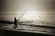 Man surf fishing, Cape Cod, MA