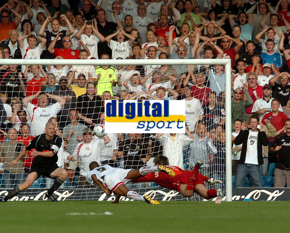 Photo: Ian Hebden.<br /> <br /> Milton Keynes Dons v Hartlepool United. Coca Cola League 2. 09/09/2006.<br /> <br /> MK Dons Clive Platt (C) heads over the bar late in the game.