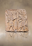 Aslantepe Hittite relief sculpted orthostat stone panel. Limestone, Aslantepe, Malatya, 1200-700 B.C. Anatolian Civilisations Museum, Ankara, Turkey. Scene of two Gods walking one carrying a spear, dressed in tunics.<br /> <br /> Against a brown art background.<br /> <br /> If you prefer to buy from our ALAMY STOCK LIBRARY page at https://www.alamy.com/portfolio/paul-williams-funkystock/hittite-art-antiquities.html . Type - Aslantepe - in LOWER SEARCH WITHIN GALLERY box. Refine search by adding background colour, place, museum etc.<br /> <br /> Visit our HITTITE PHOTO COLLECTIONS for more photos to download or buy as wall art prints https://funkystock.photoshelter.com/gallery-collection/The-Hittites-Art-Artefacts-Antiquities-Historic-Sites-Pictures-Images-of/C0000NUBSMhSc3Oo