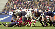 Saint-Denis, Paris, France, 23rd February 2003,  Six Nations Rugby International, France vs Scotland, Stade de France,<br /> [Mandatory Credit: Peter Spurrier/Intersport Images],<br /> Photo Peter Spurrier<br /> 23/02/2003<br /> Sport -SIX NATIONS RUGBY - France v Scotland<br /> Scotland's Bryan Redpath hang's onto the ankle of No. 8 Imanol Harinordoquy as he breaks for the back of the scrum