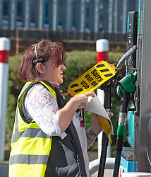 © Licensed to London News Pictures 27/09/2021.<br /> Swanley, UK, A member of staff putting out of use signs on the diesel pumps. Chaos at this Co-op petrol station in Swanley, Kent. This station had a delivery at 7.30am this morning and at 2.30pm started to run out of diesel. Fuel panic buying continues today on forecourts up and down the UK as hoarders run petrol stations dry. Photo credit:Grant Falvey/LNP