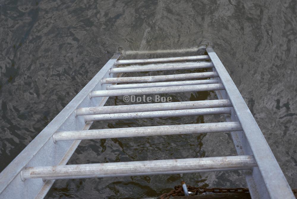 metal ladder leading to water.