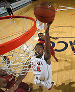 Dec. 30, 2010; Charlottesville, VA, USA; Virginia Cavaliers guard K.T. Harrell (24) shoots the ball next to Iowa State Cyclones guard Darion 'Jake' Anderson (5) during the game at the John Paul Jones Arena. Iowa State Cyclones won 60-47. Mandatory Credit: Andrew Shurtleff