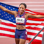 TOKYO, JAPAN August 6:   Allyson Felix of the United States celebrates with the United States flag after winning the bronze medal in the 400m for women making her the most decorated female olympic runner during the Track and Field competition at the Olympic Stadium  at the Tokyo 2020 Summer Olympic Games on August 6th, 2021 in Tokyo, Japan. (Photo by Tim Clayton/Corbis via Getty Images)