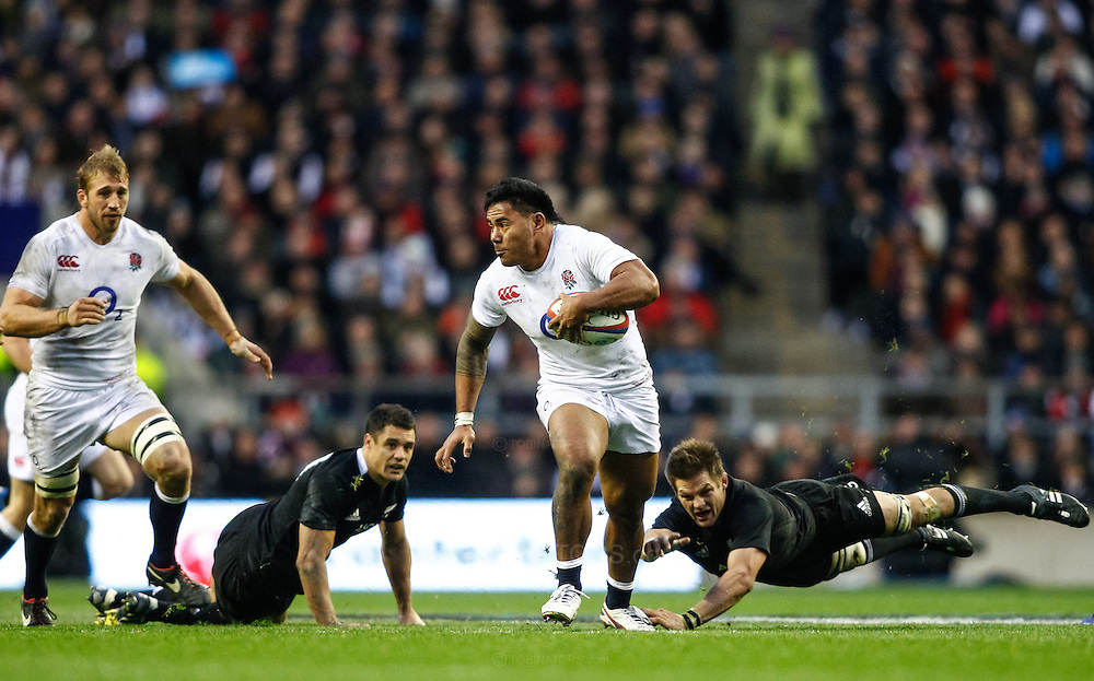 Picture by Andrew Tobin/SLIK images +44 7710 761829. 2nd December 2012. Manu Tuilagi of England escapes Richi McCaw's tackle during the QBE Internationals match between England and the New Zealand All Blacks at Twickenham Stadium, London, England. England won the game 38-21.