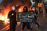 Protesters, with I can t breath justice placard, in front of burning barricade. Black tuesday commemoration of the deaths of Adama Traore in France and George Floyd in USA. Tribunal de Paris, Paris, June 2, 2020. Photography by Nigel Dickinson/Hans Lucas.<br /> Les manifestants, avec pancarte je ne peux pas respirer, justice, devant une barricade en feu. Mardi noir commemoration de la mort d Adama Traore en France et de George Floyd aux Etats-Unis. Tribunal de Paris, Paris, 2 juin 2020. Photographie par Nigel Dickinson/Hans Lucas.