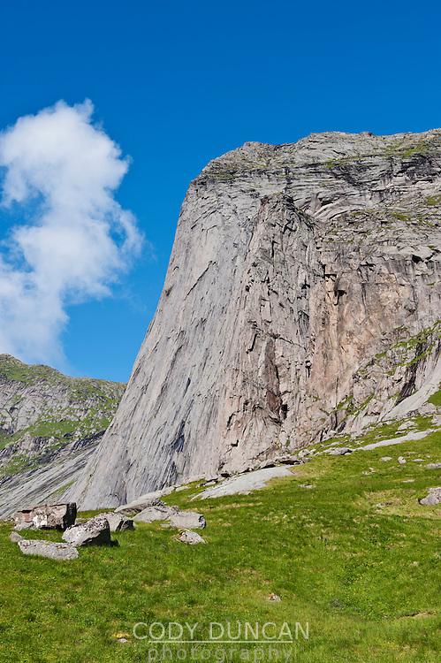 Steep granite cliff of Helvetestinden, Bunes beach, Lofoten islands, Norway