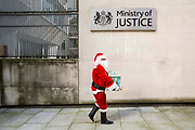 Santa  along with the Howard League, English PEN delivering books for prisoners to the Ministry of Justice HQ, central London.