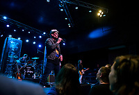 Robin Wilson of the Gin Blossoms welcomes the crowd as the band takes the stage at the Whiskey Barrel on Tuesday evening.  (Karen Bobotas/for the Laconia Daily Sun)