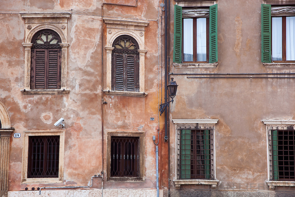 The side of a building with interesting architecture in Verona, Italy.
