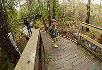 Collin Meaney and Debbie Bolduc trim limbs obstructing the Wetland's Walk during Laconia Rotary volunteer service project at Gunstock Resort Saturday morning.  Karen Bobotas for the Laconia Daily Sun