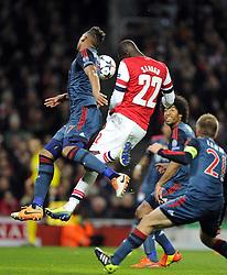 Arsenal's Yaya Sanogo heads against Bayern Munich's Jerome Boateng - Photo mandatory by-line: Joe Meredith/JMP - Tel: Mobile: 07966 386802 19/02/2014 - SPORT - FOOTBALL - London - Emirates Stadium - Arsenal v Bayern Munich - Champions League - Last 16 - First Leg