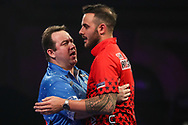 Brendan Dolan commiserates Joe Cullen at the end of the match during the World Darts Championships 2018 at Alexandra Palace, London, United Kingdom on 19 December 2018.