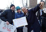 New Jersey Senator Cory Booker takes a picture with protestors as over 10,000 marched from Battery Park on Jan. 20, 2017, in New York City to voice opposition to President Donald Trump's proposed travel ban. (Photo by Matt Smith)