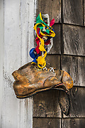 Old boot displayed on the exterior of a building, port town of Lubec, Maine, USA, furthest northeast location in the continental United States