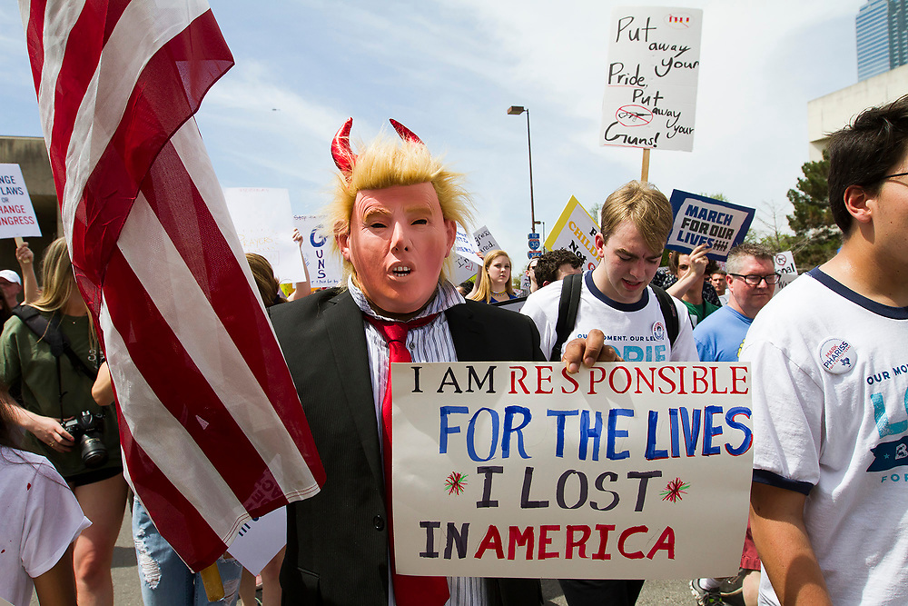 A marcher dressed to resemble President trump protests the current spate of shootings at schools during the March for Our Lives event in front of Dallas City Hall on Saturday.