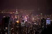 Illuminations of Hong Kong Island famous skyline at night from The Peak, China